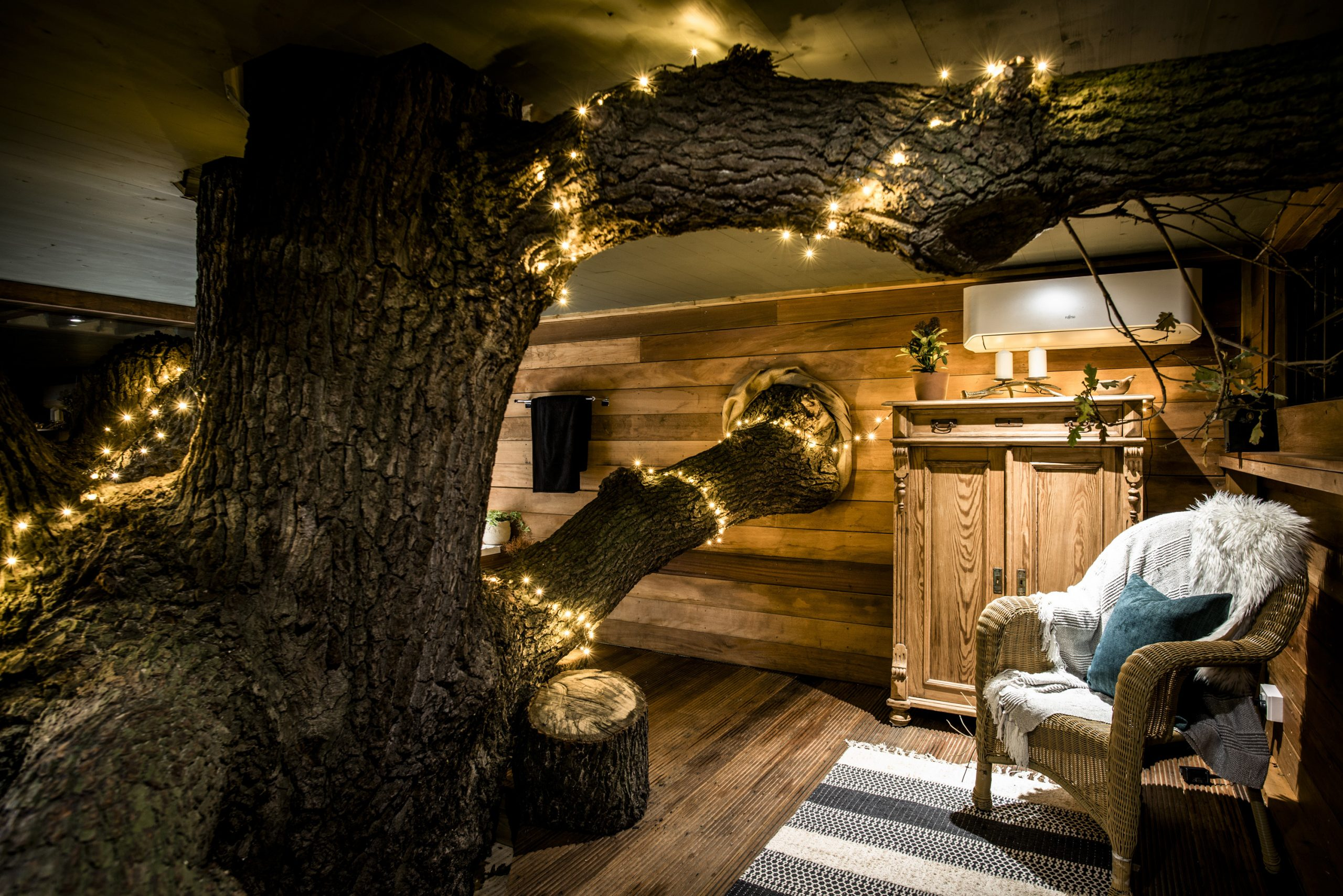 Nighttime photo inside The Old Oak at Colemans Farm showing the snug area